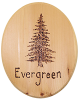 wood sign with the word evergreen burned in
