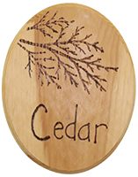 wood sign with the word Cedar burned in