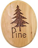 wood sign with the word pine and a tree burned into the wood